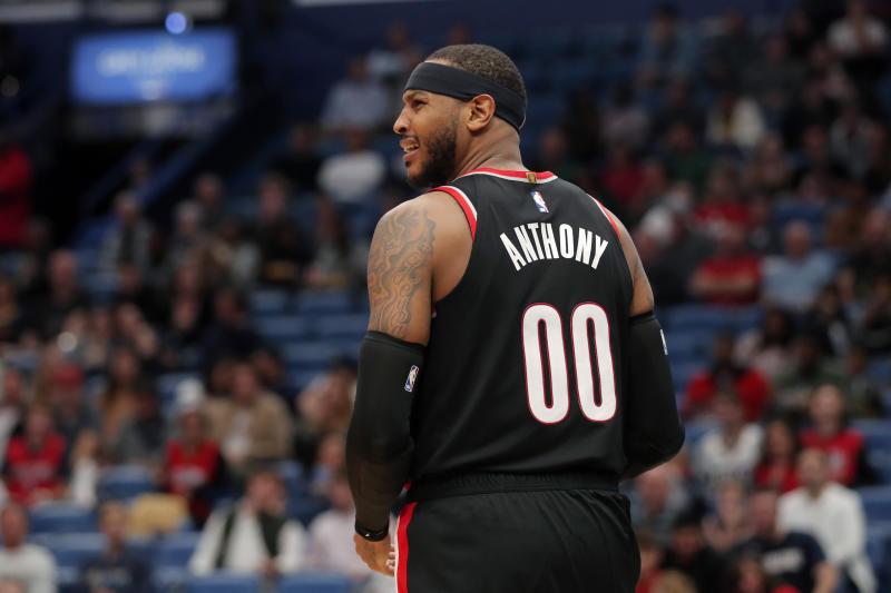 Portland Trail Blazers forward Carmelo Anthony (00) looks to a few for a foul after driving to the basket in the second half of an NBA basketball game against the New Orleans Pelicans in New Orleans, Tuesday, Nov. 19, 2019. The Pelicans won 115-104. (AP Photo/Gerald Herbert)