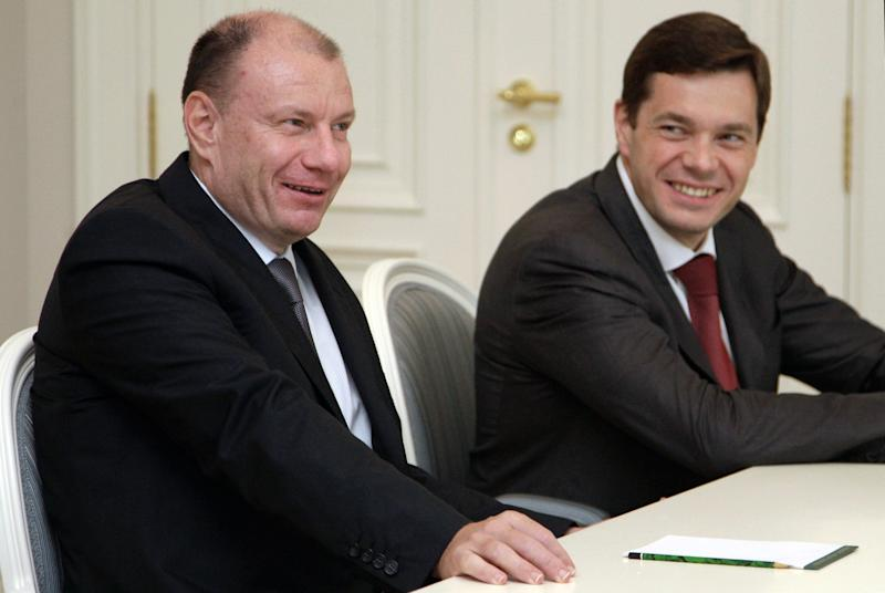 FILE In this Monday, Aug. 16, 2010 file photo Interros Investment Company President Vladimir Potanin, left, and Severstal's Chief Executive Alexei Mordashov, right, attend a meeting with then Russian President Dmitry Medvedev at the Bocharov Ruchei residence in the Black Sea resort of Sochi, southern Russia, . Russia's most powerful businessmen have reason to be worried about the economic fallout from the takeover of Crimea and the sanctions imposed by the West as forecasts for Russia's economy have dropped sharply and capital flight is soaring.(AP Photo/RIA-Novosti, Dmitry Astakhov, Presidential Press Service)