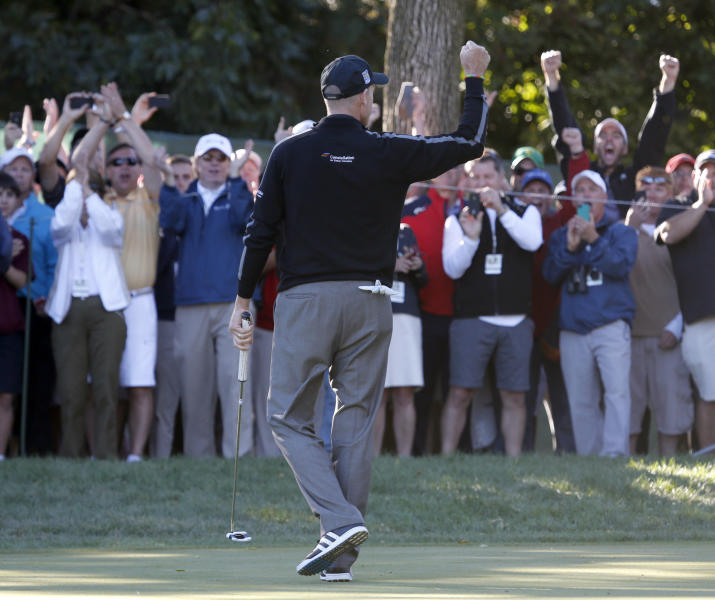 Jim Furyk pumps his fist after posting a 59, tying the PGA single round record, during the second round of the BMW Championship golf tournament at Conway Farms Golf Club in Lake Forest, Ill., Friday, Sept. 13, 2013. (AP Photo/Charles Rex Arbogast)