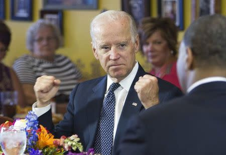 U.S. Vice President Joe Biden speaks with politicians and business owners in a round table discussion on raising the minimum wage at Casa Don Juan restaurant in Las Vegas