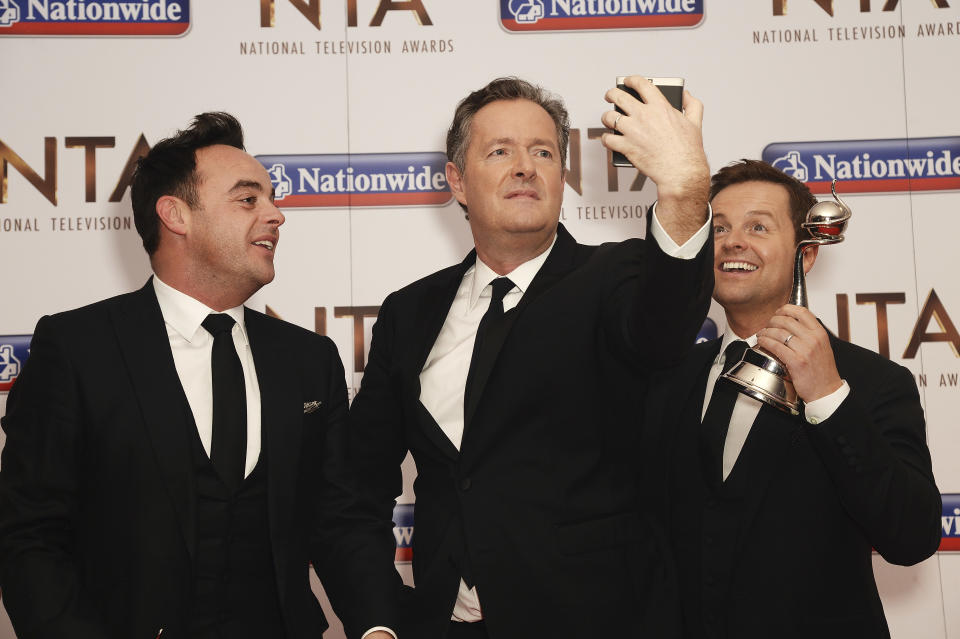 LONDON, ENGLAND - JANUARY 20:  Piers Morgan and Ant and Dec take a selfie during the 21st National Television Awards at The O2 Arena on January 20, 2016 in London, England.  (Photo by Dave J Hogan/Dave J Hogan/Getty Images)