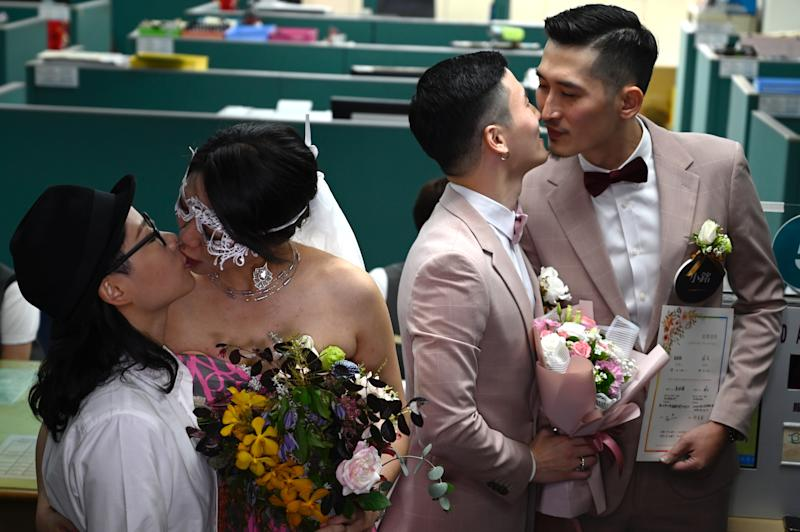 Two gay couples in Taiwan registered their marriages in Taipei on 24 May 2019, a week after lawmakers in the island approved a bill legalising gay marriages. AFP via Getty Images file photo.