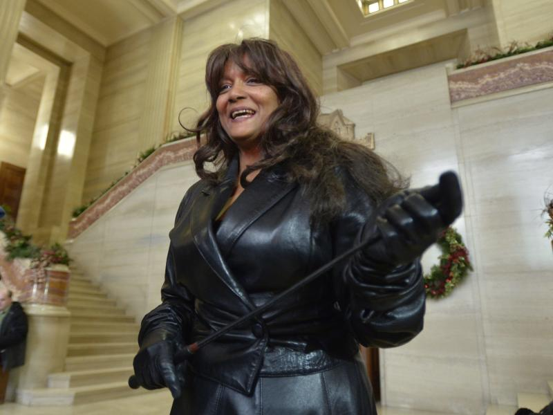 Terri-Jean Bedford talks to reporters at the Supreme Court of Canada in Ottawa Friday morning, Dec. 20, 2013 after learning Canada's highest court struck down the country's prostitution laws in their entirety in a unanimous 9-0 ruling. The retired dominatrix is one of the three principles in the Supreme Court case. The ruling is a victory for sex workers seeking safer working conditions because it found that the laws violated the guarantee to life, liberty and security of the person. But the decision also gives Parliament a one-year reprieve to respond with new legislation. (AP Photo/The Canadian Press, Adrian Wyld)