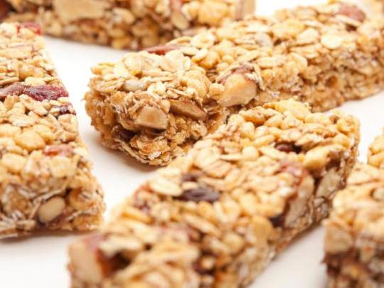 """<p>If you're in a rush getting your child to school in the morning, you might be tempted to grab a cereal bar for her to eat as she runs out the door — after all, the package says it has whole grains and real fruit, which is what she'd get from a bowl of cereal with fruit. The problem is that the """"fruit"""" in most cereal bars is primarily sugar with some added fruit juice (more sugar) — a typical bar has a tablespoon or more of sugar in it. In one brand, there are five kinds of sugar and one sugar substitute, along with partially hydrogenated oil (which contains trans fat), artificial color and flavor. Even organic brands have a fruit blend that's mostly sugar, holding together fruit powder and dried fruit. </p>"""