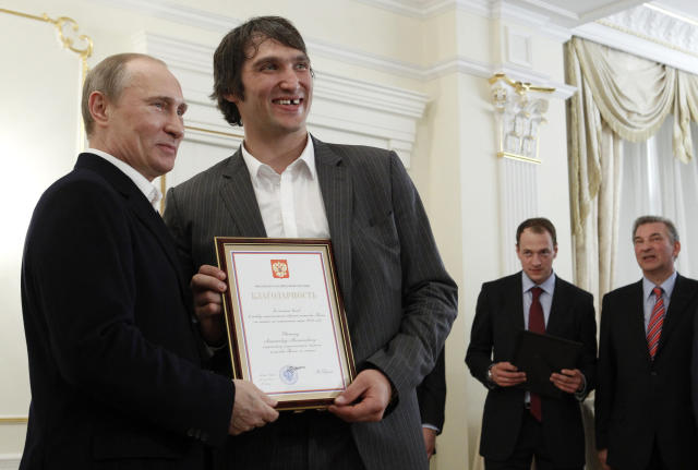 FILE – In this May 29, 2012, file photo, Russian national ice hockey team member Alexander Ovechkin, right, holds a certificate of recognition given to him by President Vladimir Putin, left, in the Novo-Ogaryovo residence outside Moscow. (AP)