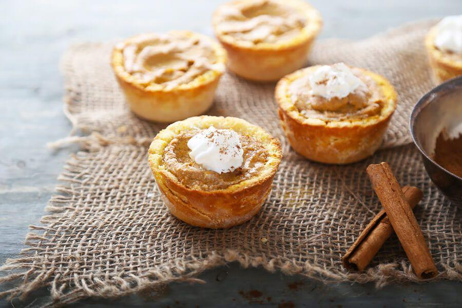 "<p>These mini pumpkin cheesecake tarts from <a href=""https://www.ruled.me/low-carb-pumpkin-cheesecake-tarts/"" rel=""nofollow noopener"" target=""_blank"" data-ylk=""slk:Ruled.me"" class=""link rapid-noclick-resp"">Ruled.me</a> are perfect for keeping portions in check, and you can use them as an easy dessert. There's a nice medley of vanilla, allspice, cinnamon, and ginger to bring out Thanksgiving spices.</p>"