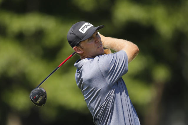 Seamus Power of Ireland hits from the 18th tee during the second round of the Rocket Mortgage Classic golf tournament, Friday, July 3, 2020, at the Detroit Golf Club in Detroit. (AP Photo/Carlos Osorio)