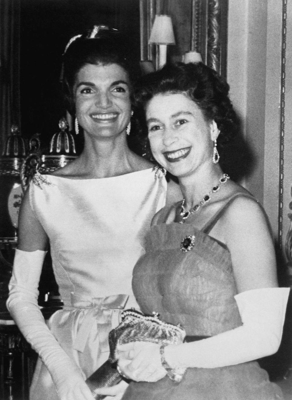 "<p> Jackie Kennedy and Queen Elizabeth pose for photos during an American state visit to Buckingham Palace. The event was the first time an American president dined at the Palace since 1918 and was even <a href=""https://www.townandcountrymag.com/society/tradition/a13128840/john-kennedy-jackie-kennedy-queen-elizabeth-meeting-buckingham-palace/"" rel=""nofollow noopener"" target=""_blank"" data-ylk=""slk:depicted on Season 2 of The Crown."" class=""link rapid-noclick-resp"">depicted on Season 2 of <em>The Crown.</em> </a></p>"