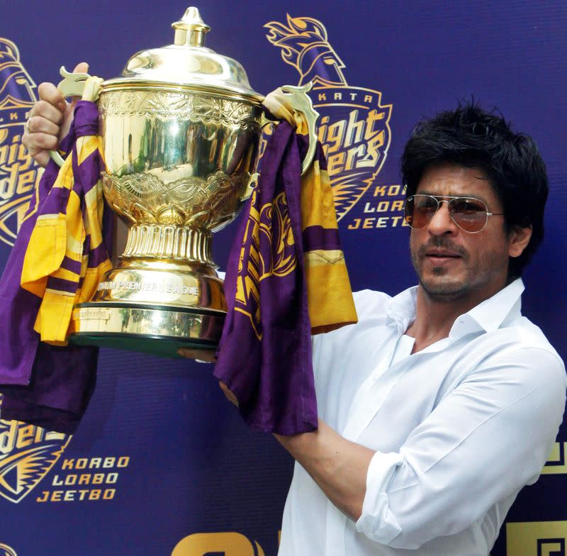 FILE PHOTO: Bollywood actor Shah Rukh Khan displays the IPL cricket trophy during a news conference at his residence in Mumbai