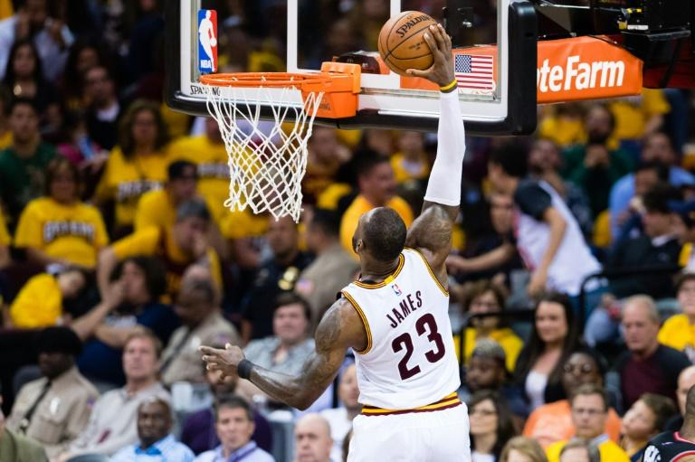 LeBron James of the Cleveland Cavaliers dunks in Game One of the NBA Eastern Conference semi-finals against the Toronto Raptors, at Quicken Loans Arena in Cleveland, Ohio, on May 1, 2017