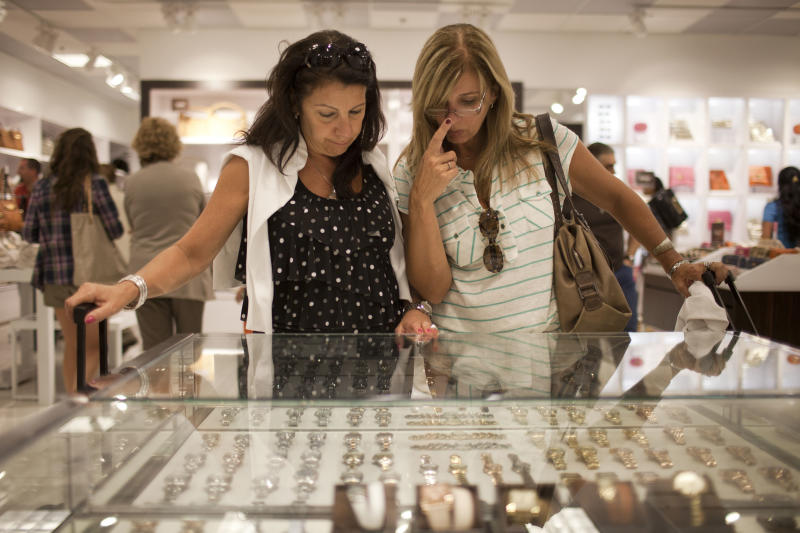 In this March 4, 2012 photo, Beatriz Cesari, left, and her friend Sylvia Schleier, from Sao Paulo, Brazil, look at watches as they shop in Miami, Florida. Brazilian travelers spend more per capita than any other visitors to the U.S.  (AP Photo/Felipe Dana)