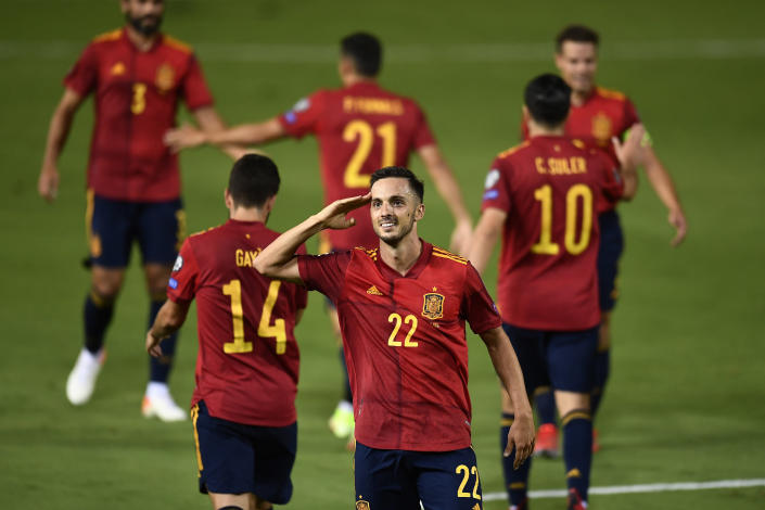 Spain's Pablo Sarabia, centre, celebrates after scoring his side's fourth goal during the World Cup 2022 group B qualifying soccer match between Spain and Georgia at the Nuevo Estadio Vivero in Badajoz, Spain, Sunday, Sept. 5, 2021. (AP Photo/Jose Breton)