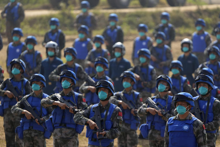 Chinese United Nations troop take part in the Shared Destiny 2021 drill at the Queshan Peacekeeping Operation training base in Queshan County in central China's Henan province Wednesday, Sept. 15, 2021. Peacekeeping troops from China, Thailand, Mongolia and Pakistan took part in the 10 days long exercise that field reconnaissance, armed escort, response to terrorist attacks, medical evacuation and epidemic control. (AP Photo/Ng Han Guan)