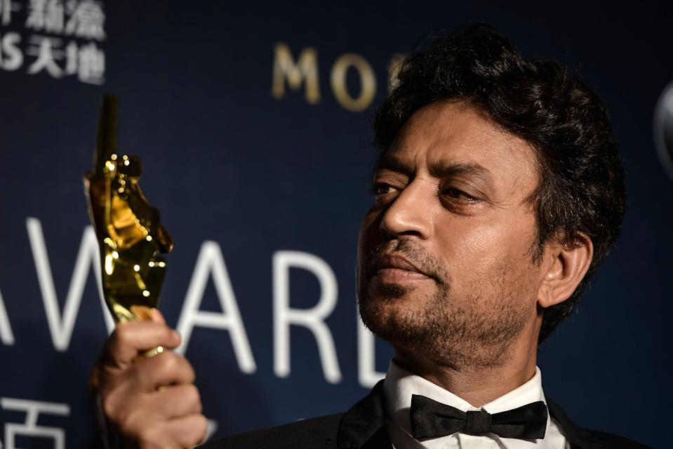 <p>File image: Irrfan Khan poses with his trophy during the Asian Film Awards in 2014</p> (Getty Images)