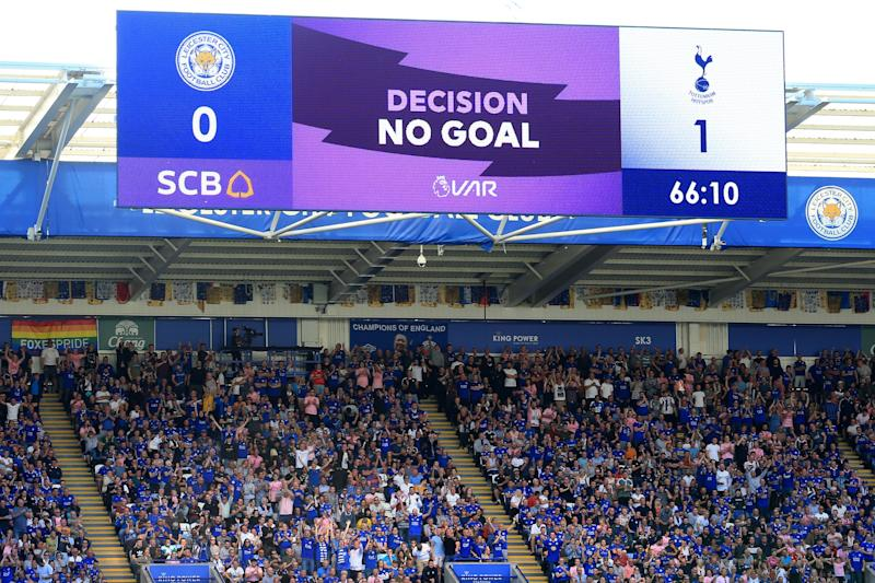 A screen displays the VAR decision to disallow Tottenham Hotspur's Ivorian defender Serge Aurier's (unseen) goal during the English Premier League football match between Leicester City and Tottenham Hotspur at King Power Stadium in Leicester, central England on September 21, 2019. (Photo by Lindsey Parnaby / AFP) / RESTRICTED TO EDITORIAL USE. No use with unauthorized audio, video, data, fixture lists, club/league logos or 'live' services. Online in-match use limited to 120 images. An additional 40 images may be used in extra time. No video emulation. Social media in-match use limited to 120 images. An additional 40 images may be used in extra time. No use in betting publications, games or single club/league/player publications. / (Photo credit should read LINDSEY PARNABY/AFP/Getty Images)