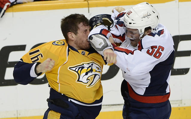 Nashville Predators forward Rich Clune (16) fights with Washington Capitals defenseman Patrick Wey (56) in the first period of an NHL hockey game on Sunday, March 30, 2014, in Nashville, Tenn. (AP Photo/Mark Zaleski)