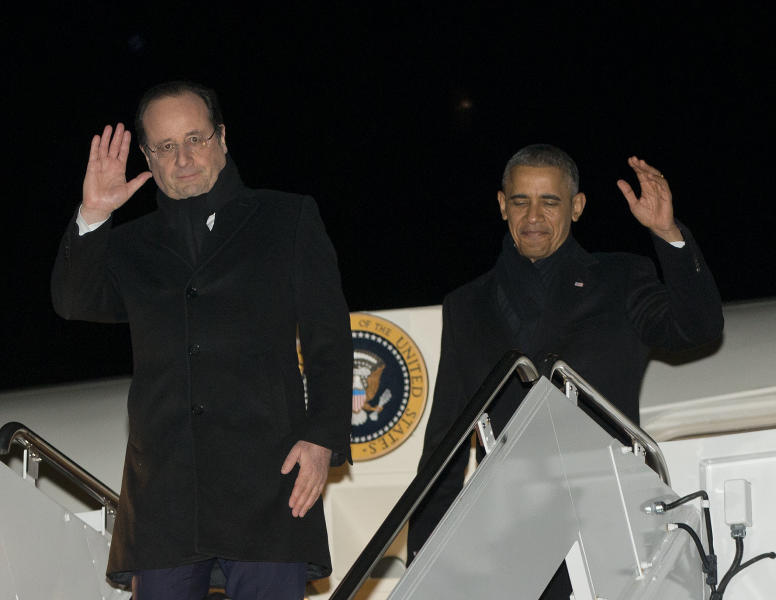 President Barack Obama, right, and French President Francois Hollande, left, wave during their return to Andrews Air Force Base on Air Force One, Monday, Feb. 10, 2014, from Charlottesville, Va., after touring Monticello, President Thomas Jefferson's estate. (AP Photo/Pablo Martinez Monsivais)