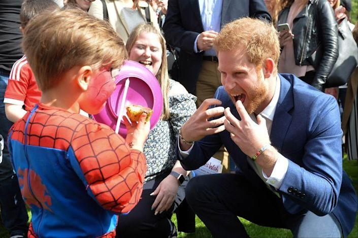 """<p>Highly doubt she's out here crouching with this kid and his cupcakes, but the <a href=""""https://www.stylist.co.uk/people/the-baffling-world-of-royal-etiquette-strange-rules-and-bizarre-protocol-over-the-ages-monarchy/22197"""" rel=""""nofollow noopener"""" target=""""_blank"""" data-ylk=""""slk:rule"""" class=""""link rapid-noclick-resp"""">rule</a> goes that if you're eating with or around Her Majesty and you forget which fork to use or which way to sit, you should take a subtle peek at her and go from there.</p>"""