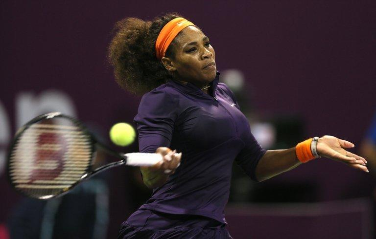 Serena Williams returns against Victoria Azarenka in their Qatar Open final in Doha on February 17, 2013