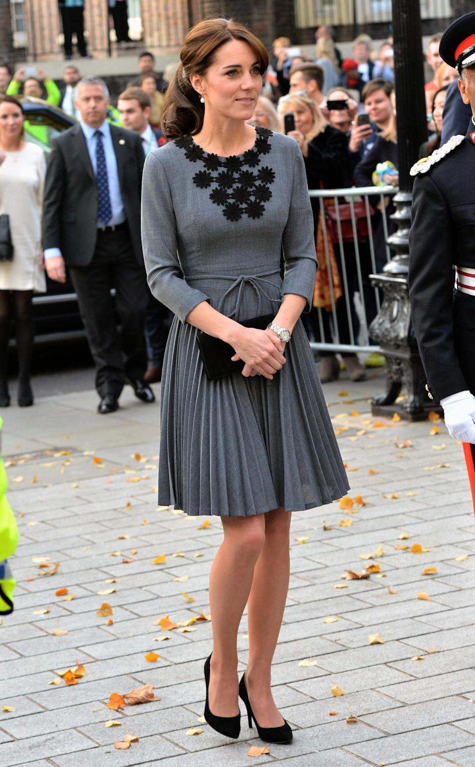 <p>For an engagement at a children's mentoring programme, Kate wore a grey Orla Kiely dress from the designer's AW11 collection. Stuart Weitzman pumps and a black suede Mulberry clutch completed her look. </p><p><i>[Photo: PA]</i></p>