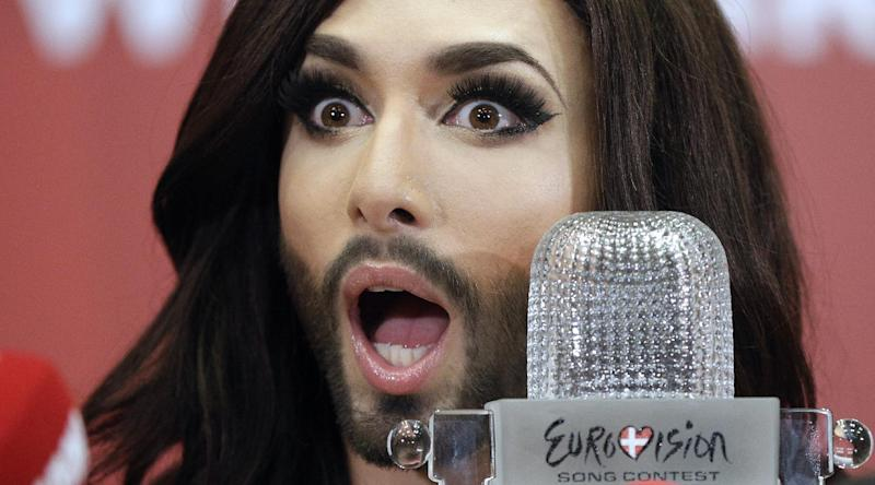 Eurovision Song Contest 2014 winner Conchita Wurst representing Austria addresses a press conference after arriving at Schwechat airport near Vienna on May 11, 2014 (AFP Photo/Georg Hochmuth)