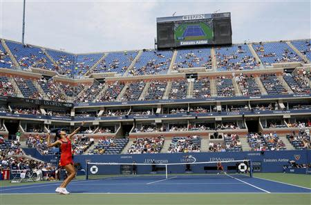 Ana Ivanovic of Serbia (L) serves to Christina McHale of the U.S. at the U.S. Open tennis championships in New York August 31, 2013. REUTERS/Ray Stubblebine