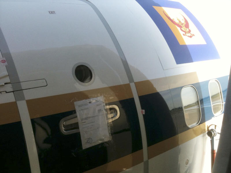 """This photo dated July 12, 2011,  provided by liquidator company Schneider, Geiwitz and Partner on Wednesday, July 13, 2011, shows the seal of a bailiff on the door of a grounded Boeing 737 of the Royal Thai Air Force at the airport in Munich.   Officials say the  plane being used by Thailand's Crown Prince Vajiralongkorn has been impounded in Germany as part of a long-running battle over payments for a building project in Thailand, and Munich airport spokesman Robert Wilhelm said Wednesday July 13, 2011, that the Boeing 737 """"Royal Flight"""" was seized on a court order, and is now immobilized and sealed at the airport. (AP Photo/Schneider, Geiwitz & Partner) EDITORIAL USE ONLY"""