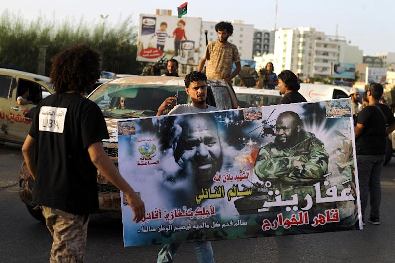 Libyan men take part in a protest against a new government proposed by UN envoy Bernardino Leon, in the eastern city of Benghazi, on October 9, 2015