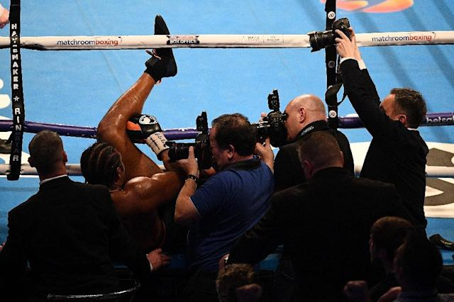 David Haye was stopped for the first time since 2004 after Tony Bellew knocked him out of the ring prompting trainer Shane McGuigan to throw in the towel (AFP Photo/Justin TALLIS)