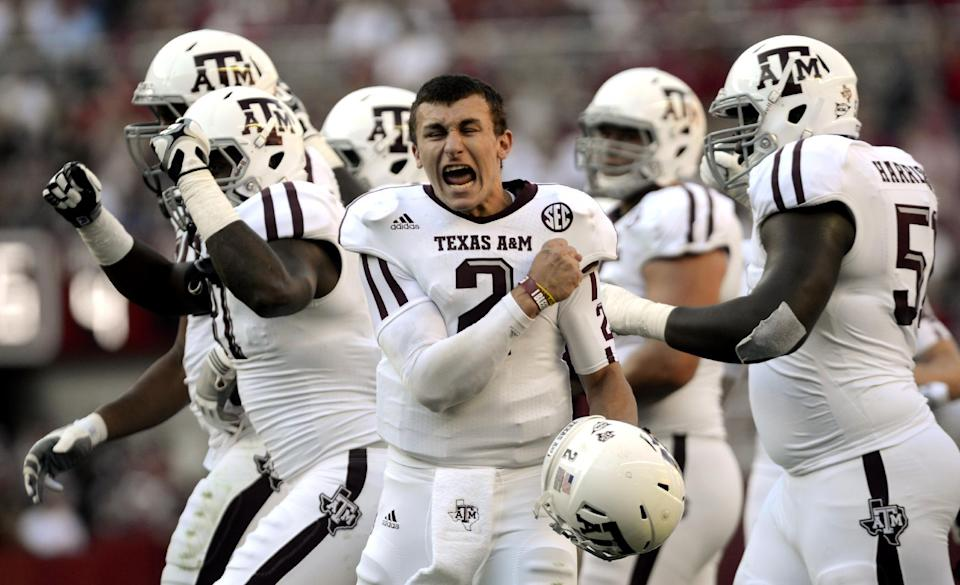 Texas A&M quarterback Johnny Manziel (2) celebrates after a review proves an Aggie touchdown during the first half of their first SEC meeting against Alabama in an NCAA college football game in Tuscaloosa, Ala on Nov. 10, 2012. Manziel has become the first freshman to be voted The Associated Press Player of the Year in college football. (AP Photo/The Decatur Daily, Gary Cosby Jr.)