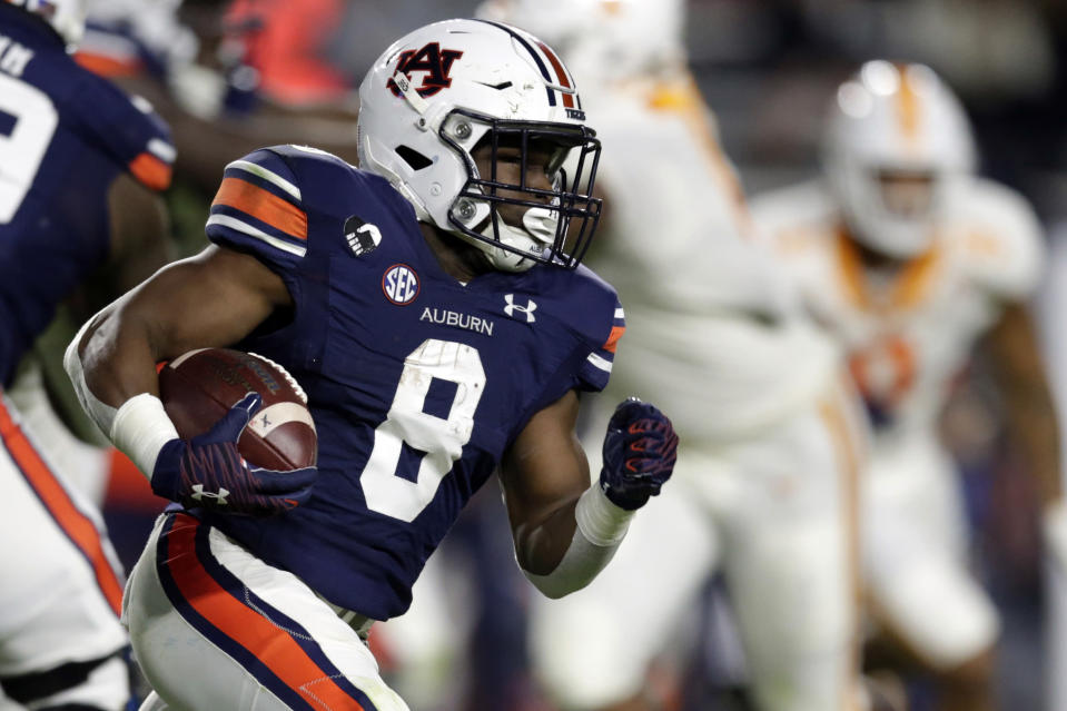 Auburn running back Shaun Shivers carries the ball during the first half of the team's NCAA college football game against Tennessee on Saturday, Nov. 21, 2020, in Auburn, Ala. (AP Photo/Butch Dill)