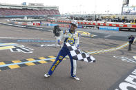 Chase Elliott celebrates at the finish line after winning the season championship and a NASCAR Cup Series auto race at Phoenix Raceway, Sunday, Nov. 8, 2020, in Avondale, Ariz. (AP Photo/Ralph Freso)