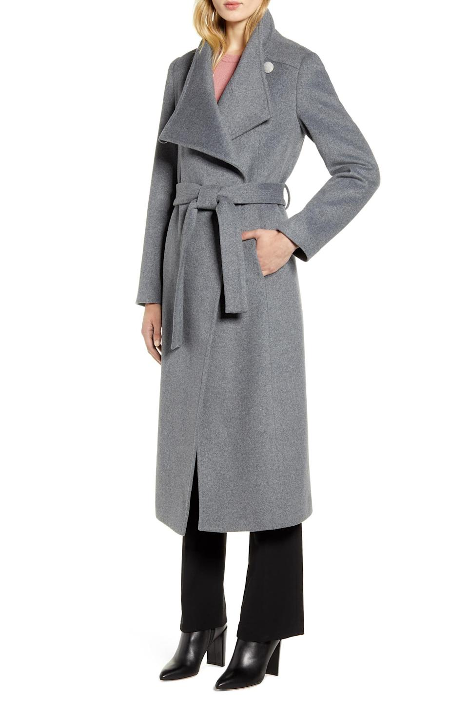 """<p><strong>KENNETH COLE NEW YORK</strong></p><p>nordstrom.com</p><p><strong>$178.00</strong></p><p><a href=""""https://go.redirectingat.com?id=74968X1596630&url=https%3A%2F%2Fshop.nordstrom.com%2Fs%2Fkenneth-cole-new-york-fencer-melton-wool-maxi-coat%2F5040952&sref=https%3A%2F%2Fwww.prevention.com%2Fbeauty%2Fstyle%2Fg29473259%2Fbest-winter-coats%2F"""" rel=""""nofollow noopener"""" target=""""_blank"""" data-ylk=""""slk:SHOP NOW"""" class=""""link rapid-noclick-resp"""">SHOP NOW</a></p><p>For an affordable price tag, this warm winter coat is made with 65 percent wool, 30 percent polyester, and five percent other fibers. We love its double-breasted design and <strong>tie belt that cinches perfectly around your waist</strong>. Nordstrom customers recommend ordering a size up so you won't feel constricted wearing bulkier pieces of clothing. </p><p>""""Classy long coat. Fits me well and still looks youthful. I received compliments the first night I stepped out in it! For the northeast it's perfect, so you can wear cute dresses and still feel weather appropriate,"""" a Nordstrom customer says. </p>"""