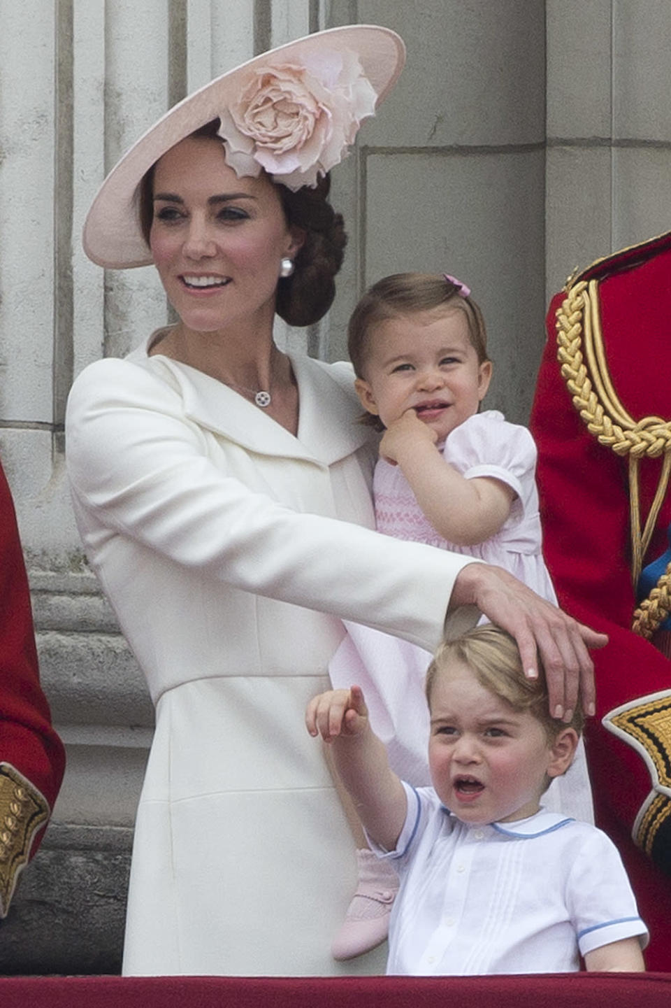 The Duchess of Cambridge took Princess Charlotte to her debut Trooping the Colour ceremony in 2016. For the prestigious event, Kate donned an Alexander McQueen dress while her children, George and Charlotte, wore looks by Pepe & Co. (Getty Images)