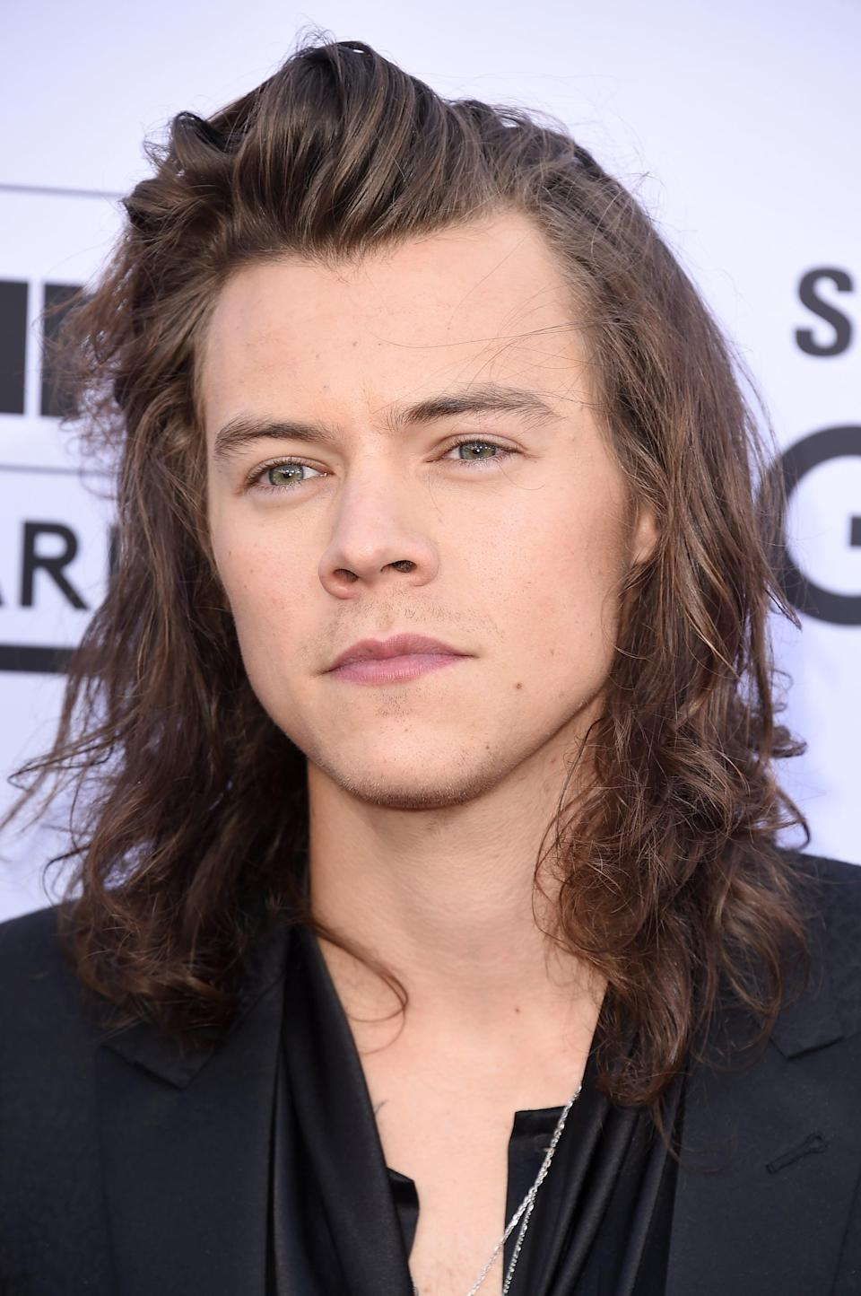 <p>And the curls just kept growing into long waves, swooped off his forehead to the side.</p>