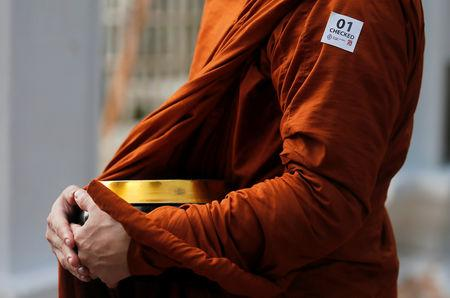 A sticker for people who have been under security checking is seen on a Buddhist monk at the Kelaniya Buddhist temple during Vesak Day, commemorating the birth, enlightenment and death of Buddha, in Colombo, Sri Lanka May 18, 2019. REUTERS/Dinuka Liyanawatte