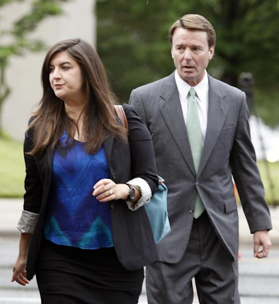 Cate Edwards leads her father, John Edwards, into the federal courthouse in Greensboro, N.C., as the defense starts in his campaign corruption trial, Monday, May 14, 2012. (AP Photo/Bob Leverone)
