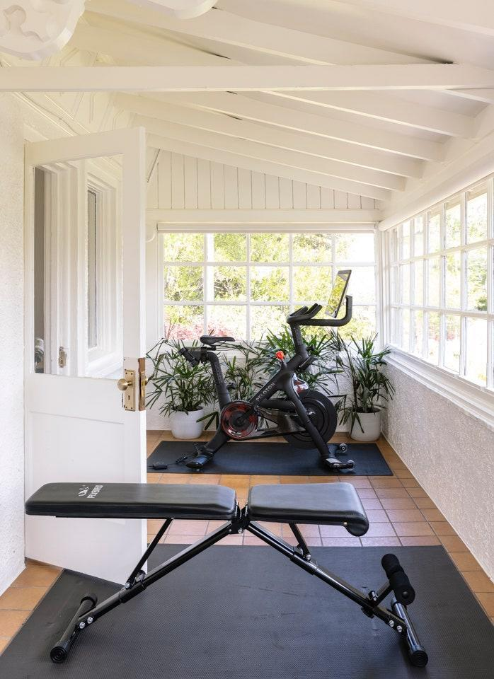 Since the home was designed and built not long after the Spanish Flu—which ended in 1920—Chakrabarti and Alataris suspect this screened-in room might have been a sleeping porch, meant to let in sunlight and fresh air. The new inhabitants have turned the charming room into a home gym.