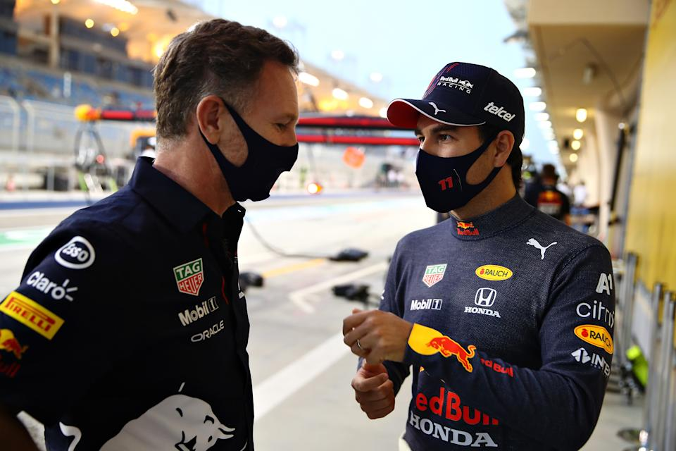 BAHRAIN, BAHRAIN - MARCH 26: Red Bull Racing Team Principal Christian Horner and Sergio Perez of Mexico and Red Bull Racing talk during practice ahead of the F1 Grand Prix of Bahrain at Bahrain International Circuit on March 26, 2021 in Bahrain, Bahrain. (Photo by Mark Thompson/Getty Images)