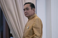 Thailand's Prime Minister Prayuth Chan-ocha leaves after a press conference at Government House in Bangkok, Thailand, Tuesday, Dec. 1, 2020. Thailand's highest court is set to rule Wednesday, Dec. 2, 2020 on whether Prayuth has breached ethics clauses in the country's constitution and should be ousted from his position. (AP Photo/Sakchai Lalit)