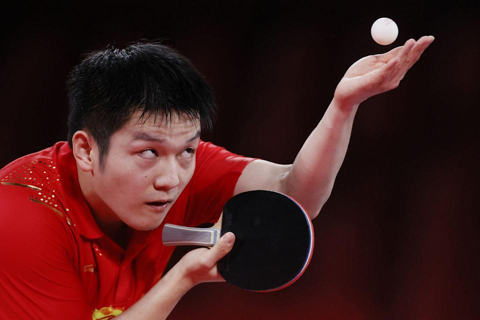 <p>Fan Zhengdong of Team China serves the ball during his men's singles semifinals match.</p>