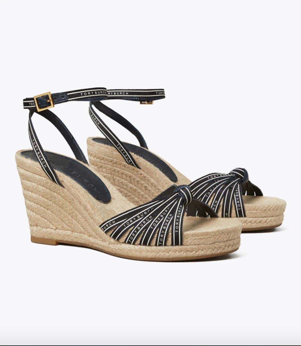 """<p><strong>Tory Burch</strong></p><p>toryburch.com</p><p><strong>$248.00</strong></p><p><a href=""""https://go.redirectingat.com?id=74968X1596630&url=https%3A%2F%2Fwww.toryburch.com%2Ftory-ribbon-wedge-espadrille%2F82755.html&sref=https%3A%2F%2Fwww.townandcountrymag.com%2Fstyle%2Ffashion-trends%2Fg36200206%2Fsummer-shoes%2F"""" rel=""""nofollow noopener"""" target=""""_blank"""" data-ylk=""""slk:Shop Now"""" class=""""link rapid-noclick-resp"""">Shop Now</a></p><p>Dainty navy ribbons and an easy-to-walk-in woven wedge heel bring a nautical vibe that will complete any shoreside look. </p>"""