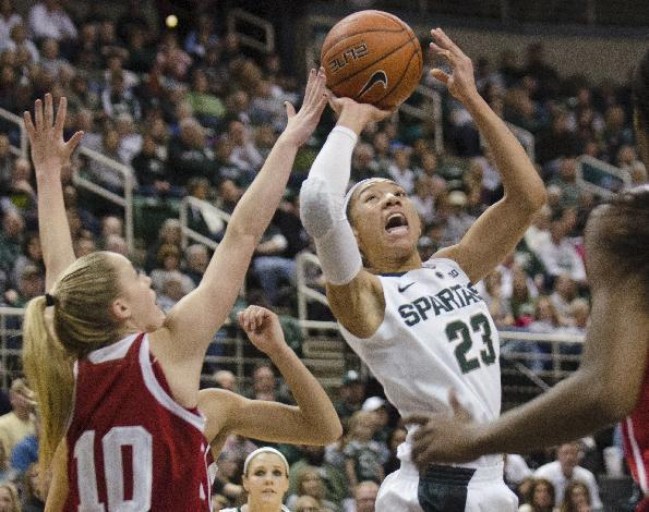 Michigan State's Aerial Powers, right, shoots over Indiana's Taylor Agler during an NCAA college basketball game Sunday, March 2, 2014, in East Lansing, Mich. (AP Photo/The Saginaw News, Tim Goessman)