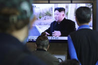 People watch a TV showing a file image of North Korean leader Kim Jong Un during a news program at the Seoul Railway Station in Seoul, South Korea, Saturday, May 2, 2020. Kim made his first public appearance in several weeks as he celebrated the completion of a fertilizer factory near Pyongyang, state media said Saturday, ending an absence that had triggered global rumors that he was seriously ill. (AP Photo/Ahn Young-joon)
