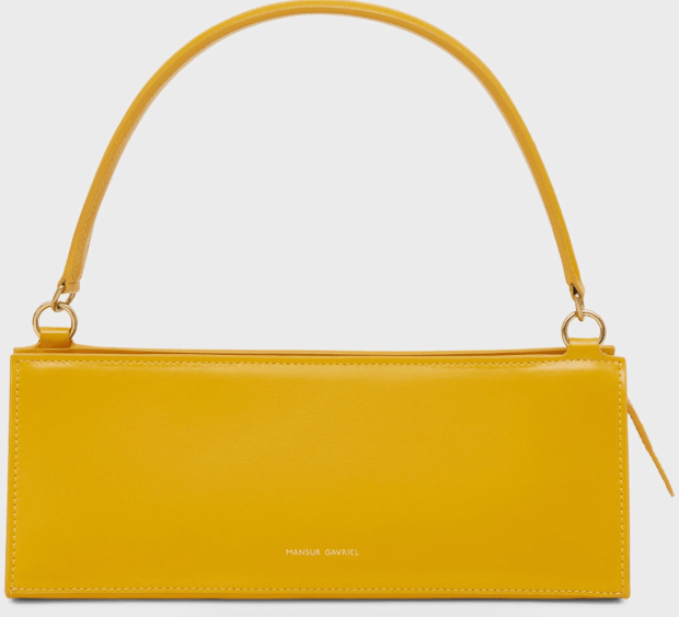 """<p>Mansur Gavriel Pencil Bag, $495, <a href=""""https://rstyle.me/+qZx275qbYJhbsNjmXQLD_g"""" rel=""""nofollow noopener"""" target=""""_blank"""" data-ylk=""""slk:available here"""" class=""""link rapid-noclick-resp"""">available here</a></p>"""