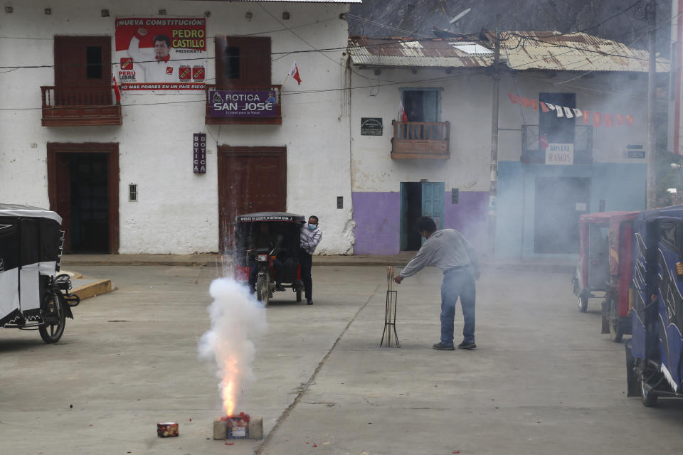 Supporters of President-elect Pedro Castillo launch fireworks during a live broadcast of his swearing-in ceremony at a public square in Tacabamba, Peru, located in the Cajamarca department where Castillo is from, Wednesday, July 28, 2021, on his Inauguration Day. (AP Photo/Francisco Vigo)