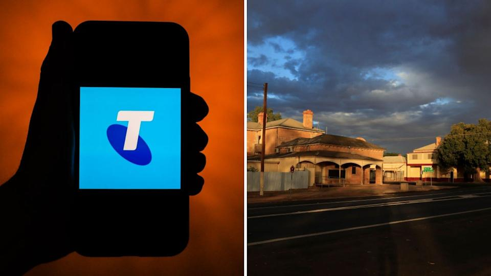 SIlhouette of phone with Telstra logo, Wilcannia street at sunset.