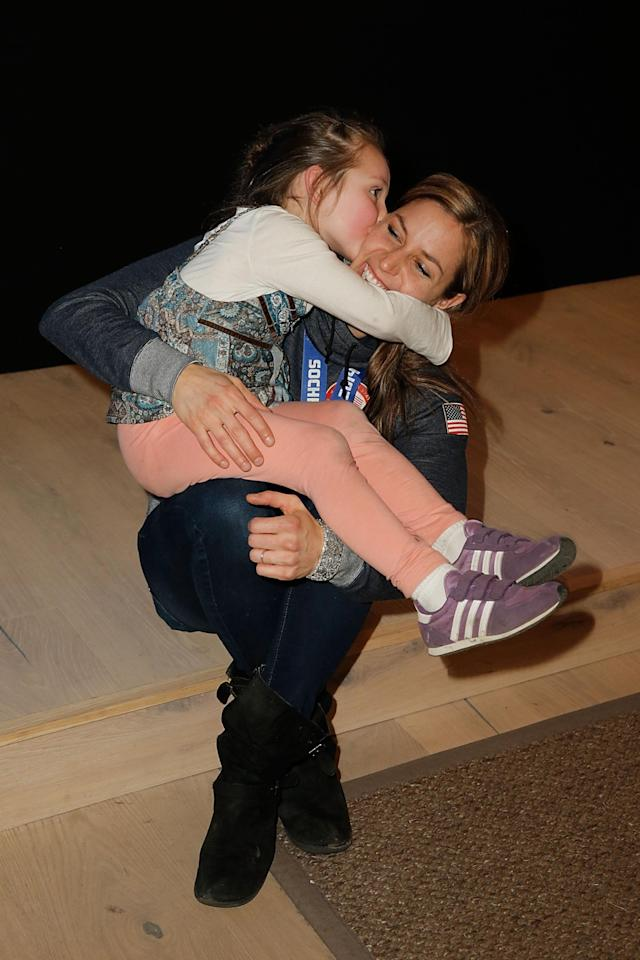 SOCHI, RUSSIA - FEBRUARY 16: U.S. Olympian Noelle Pikus-Pace and daughter Lacee Pace visit the USA House in the Olympic Village on February 16, 2014 in Sochi, Russia. (Photo by Joe Scarnici/Getty Images for USOC)
