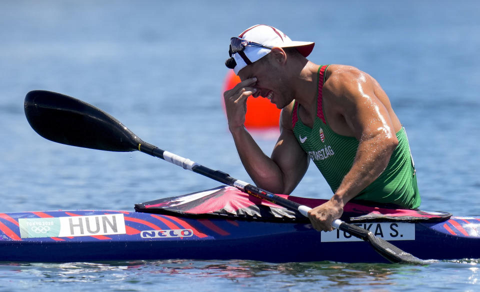 Sandor Totka, of Team Hungary, reacts after winning the gold medal in the men's kayak single 200m final at the 2020 Summer Olympics, Thursday, Aug. 5, 2021, in Tokyo, Japan. (AP Photo/Kirsty Wigglesworth)