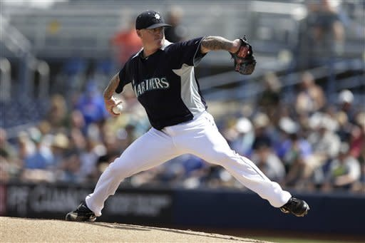 Seattle Mariners starting pitcher Jeremy Bonderman throws against the Kansas City Royals during the first inning in an exhibition spring training baseball game Tuesday, March 26, 2013, in Peoria, Ariz. (AP Photo/Gregory Bull)